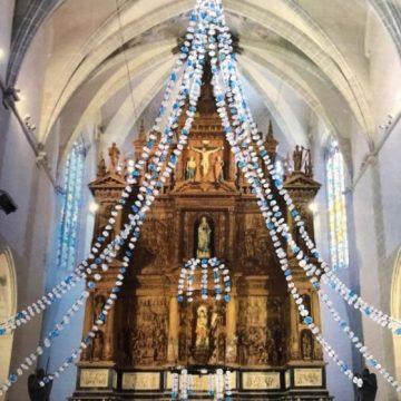 La Unió Anelles de la Flama recupera la tradició de guarnir l'església de Sant Joan de Valls amb neules per Nadal